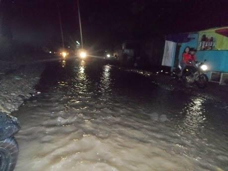 Jalan Babakan Madang Tak Ubahnya Aliran Sungai 233